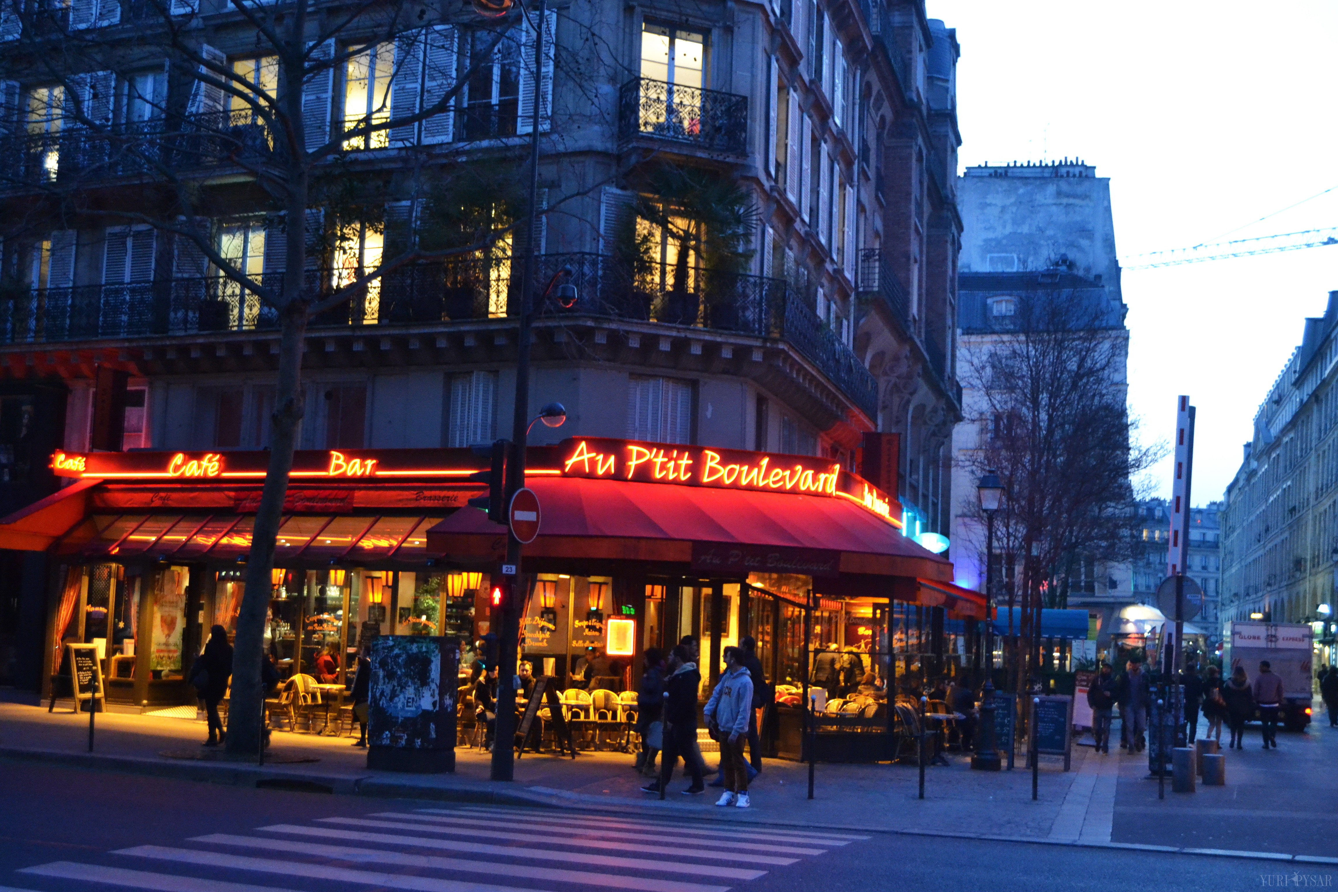 Cafe in Paris in evening lights